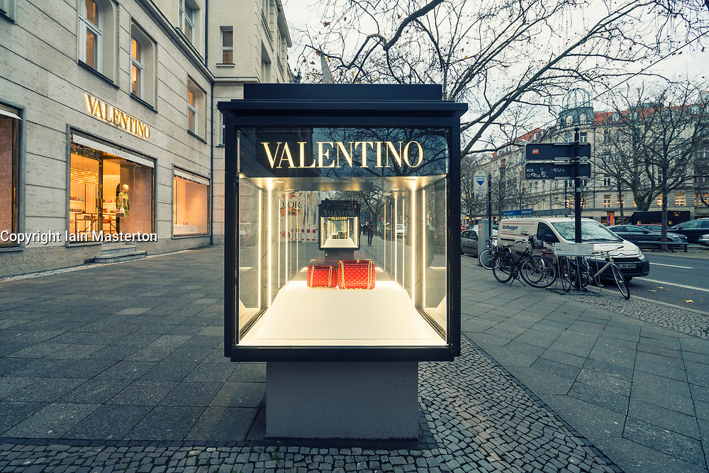 Glass display cabinet showing handbags for luxury boutique Valentino on famous shopping street Kurfurstendamm , Kudamm, in Berlin, Germany.