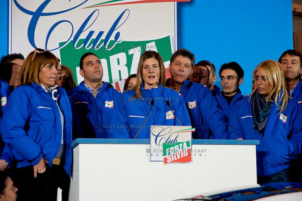 Roma 21 Febbraio 2014<br /> Presentata oggi a Roma  'Missione Azzurra', 200 volontari dei Club Forza Silvio, di Silvio Berlusconi, organizzati in venti equipaggi di due volontari ciascuno, a bordo di 20 Fiat Cinquecento, percorreranno le strade d'Italia con un obiettivo: parlare a milioni di italiani per fare conoscere il progetto politico di Silvio Berlusconi.Al microfono, il  responsabile nazionale del Movimento giovanile Annagrazia Calabria<br /> Rome  21 Febraury 2014<br /> &nbsp;Presented today in Rome ' Mission Blue ', 200 volunteers of the Club Force  Silvio, of Silvio Berlusconi, organized into twenty teams of two volunteers each , on board 20 Fiat Cinquecento, will walk the streets of Italy with one goal : to speak to millions of Italians to make know the political project of Silvio Berlusconi. At the microphone , the head of the National Youth Movement Annagrazia Calabria