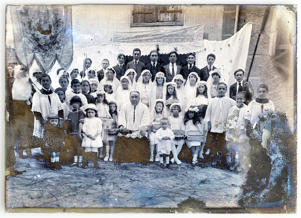 fading glass plate with group during holy communion celebration