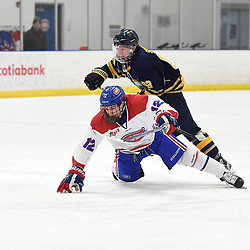 TORONTO, ON  - JAN 7,  2018: Ontario Junior Hockey League game between the Toronto Jr. Canadiens and the Buffalo Jr. Sabres, Jeremy Smith #12 of the Toronto Jr. Canadiens tries to keep the puck from Michael Sciore #63 of the Buffalo Jr. Sabres during the first period.<br /> (Photo by Andy Corneau / OJHL Images)