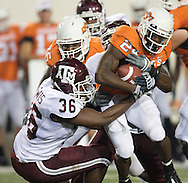 Oklahoma State running back Kendall Hunter is pulled down by Texas A&M linebacker Anthony Lewis on October 4, 2008 at T. Boone Pickens Stadium in Stillwater, Oklahoma.