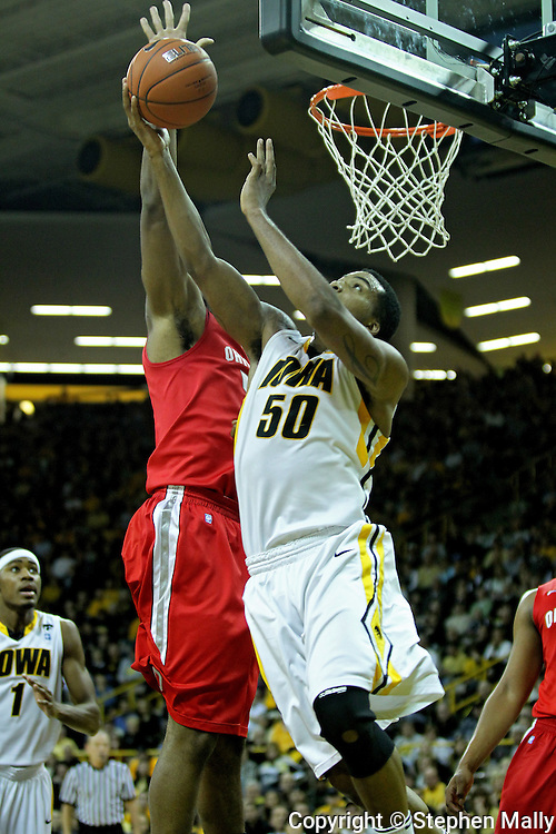 January 04 2010: Iowa Hawkeyes forward Jarryd Cole (50) has his shot blocked by Ohio State Buckeyes forward Dallas Lauderdale (52) during the first half of an NCAA college basketball game at Carver-Hawkeye Arena in Iowa City, Iowa on January 04, 2010. Ohio State defeated Iowa 73-68.