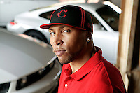 Portrait of NBA star from the Phoenix Suns, Shawn Marion near his home in Chicago  Illinois with some of his all white cars he collects Aug. 1, 2005 Chicago.   photo by Darren Hauck.