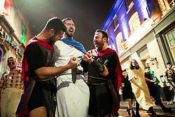 © Licensed to London News Pictures . 26/12/2018. Wigan, UK. Caesar is stabbed on King Street . Revellers in Wigan enjoy Boxing Day drinks and clubbing in Wigan Wallgate . In recent years a tradition has been established in which people go out wearing fancy-dress costumes on Boxing Day night . Photo credit: Joel Goodman/LNP