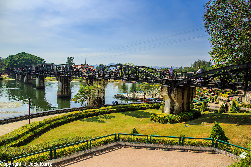 """07 JANUARY 2013 - KANCHANABURI, THAILAND: The """"Bridge On the River Kwai"""" in Kanchanaburi, Thailand. Hundreds of thousands of Asian slave laborers and Allied prisoners of war died in World War II making the railway between Bangkok and Rangoon (now Yangon), Burma (now Myanmar) for the Japanese.  Thailand has a very advanced rail system and trains reach all parts of the country.    PHOTO BY JACK KURTZ"""