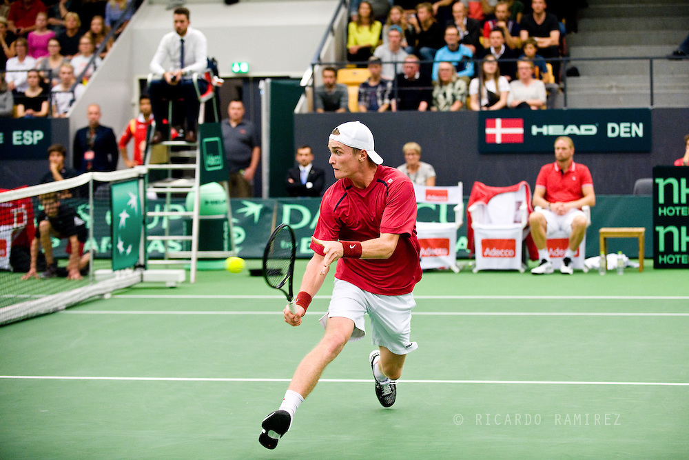 18.09.2015. Odense, Denmark. <br /> Mikael  Torpegaard of Denmark returns a shot during his Davis Cup match against Rafael Nadal of Spain.<br /> Photo: © Ricardo Ramirez.