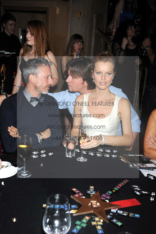 Left to right, PATRICK COX, EVA HERZIGOVA and GREGORIO MARSIAJ at a party to celebrate the launch of Hollywood Domino - a brand new board game, held at Mosimann's 11b West Halkin Street, London on 7th November 2008.  The evening was in aid of Charlize Theron's Africa Outreach Project.
