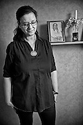 Berith Kalander, Swedish Kalderash Roma. On a shelf behind her is a photograph of her mother, who was born in Poland and who survived Auschwitz. The mother came to Sweden at  the end of WW2 with the famous Swedish Red Cross white buses.