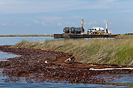 Oil washed up on the shores of Bay Jimmy in Barataria bay despite the clean-up crews efforts. Bay Jimmy which is part of  Barataria Bay that has been greatly impacted by oil from the BP Deepwater Horizon wellhead.