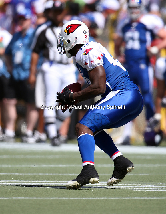 HONOLULU, HI - FEBRUARY 08: NFC All-Stars wide receiver Anquan Boldin #81 of the Arizona Cardinals looks for running room after catching a pass against the AFC All-Stars in the 2009 NFL Pro Bowl at Aloha Stadium on February 8, 2009 in Honolulu, Hawaii. The NFC defeated the AFC 30-21. ©Paul Anthony Spinelli *** Local Caption *** Anquan Boldin