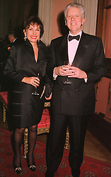 SIR CHARLES & LADY POWELL at a dinner in Berkshire on 19th November 1998.MME 41