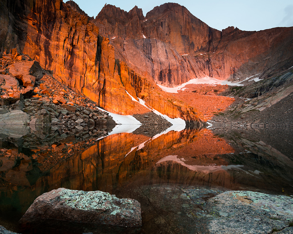 A cloudy late July morning at Chasm Lake was enlivened by a gap in the clouds far off to the east which allowed around eight minutes of intense sunrise light to progress down the east face of Longs Peak.