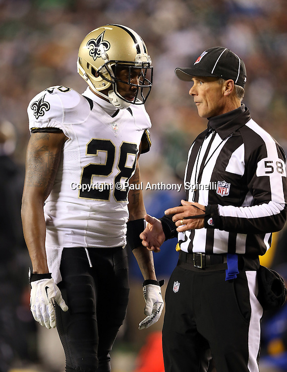 New Orleans Saints cornerback Keenan Lewis (28) talks to an official during the NFL NFC Wild Card football game against the Philadelphia Eagles on Saturday, Jan. 4, 2014 in Philadelphia. The Saints won the game 26-24. ©Paul Anthony Spinelli