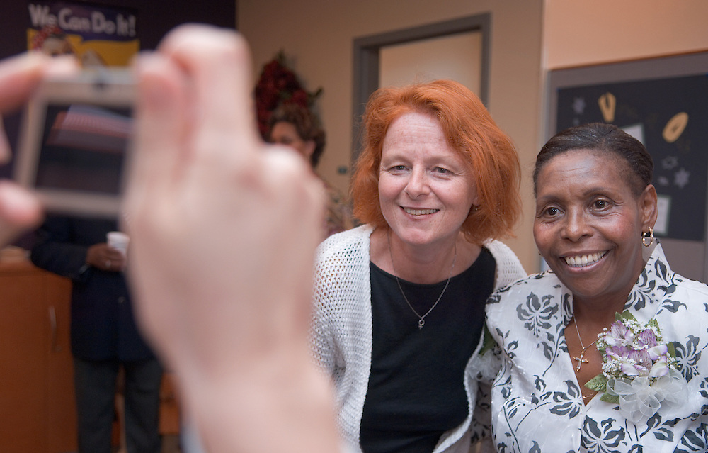 18385Welcome reception for the new Director of the Women's Center, Dr. Susanne B. Dietzel.. Dr. Susanne B. Dietzel takes picture with Beatrice Selotlegeng