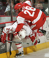 Boston University's Freddy Meyer collides with UNO's Scotty Turner.  UNO won 4-3 in during Friday's (dec. 21) overtime match.<br /> (photo by Chris Machian/Prairie Pixel Group)