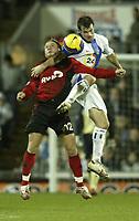 Photo: Aidan Ellis.<br /> Blackburn Rovers v Bayer Leverkusen. UEFA Cup, 2nd Leg. 22/02/2007.<br /> Rovers Ryan Nelsen (R) in an Aerial battle with Bayer's Adrej Voronin