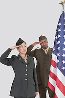 Multi-ethnic US military officers saluting American flag over gray background