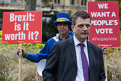 London, UK. 16th November, 2018. Gerard Batten, Leader of UKIP, appears on College Green in Westminster as uncertainty continues around the survival of Prime Minister Theresa May's Government and the number of letters of no confidence submitted to the 1922 Committee. Anti-Brexit activist Steve Bray of SODEM stands behind him holding two placards.