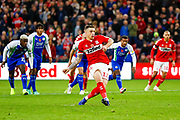 Middlesbrough forward Jordan Hugill (11) on loan from West Ham United, scores a goal to make the score 1-0  during the EFL Sky Bet Championship match between Middlesbrough and Wigan Athletic at the Riverside Stadium, Middlesbrough, England on 10 November 2018.