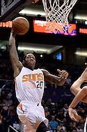 Feb 8, 2016; Phoenix, AZ, USA; Phoenix Suns guard Archie Goodwin (20) dunks the ball against the Oklahoma City Thunder at Talking Stick Resort Arena. Mandatory Credit: Jennifer Stewart-USA TODAY Sports