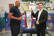 Mike Powell (USA), left and IAAF Continental Cup Ostrava 2018 chief executive officer Valter Bocek pose with USA singlet worn by Powell to set the long jump world record at the 1991 World Championships at the IAAF World Heritage/Continental Cup Exhibition at the Forum Nova Karolina Shopping Centre in Ostrava, Czech Republic, Tuesday, June 12, 2018. (Jiro Mochizuki/Image of Sport)