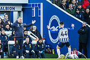 Dean Smith, Head Coach of Aston Villa FC & Aaron Connolly (Brighton) raise their arms as Marvelous Nakamba (Aston Villa) falls to the ground near the tunnel during the Premier League match between Brighton and Hove Albion and Aston Villa at the American Express Community Stadium, Brighton and Hove, England on 18 January 2020.