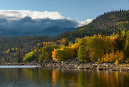 Fall foliage is reflected in Long Lake in the Cloud Peak Wilderness. Up above, snow was falling on the higher peaks.