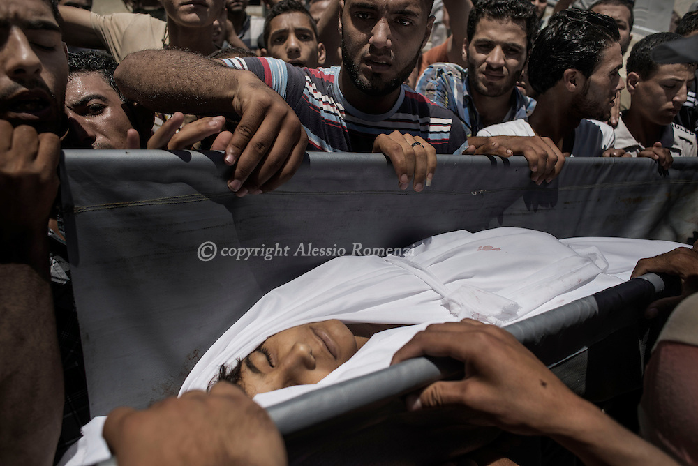 Gaza Strip, Beit Hanun: Relatives of Mohammed Masri (9 yo), killed along with his mother by Israeli airstrike on July 9, 2014, carried his body out of the mosque in Beit Hanun (north of Gaza Strip). ALESSIO ROMENZI