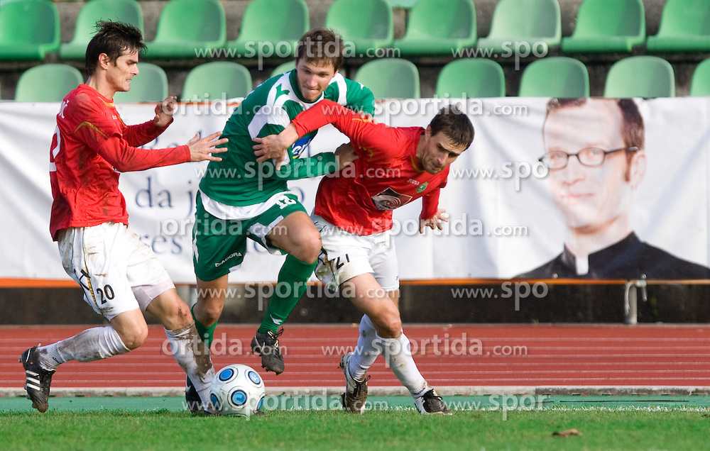 David Kasnik of Olimpija between Alem Mujakovic of Rudar and Rusmin Dedic of Rudar at  football match of 21st Round of First League between NK Olimpija and NK Rudar Velenje, on December 2, 2009,  in ZSD Ljubljana, Ljubljana, Slovenia.  Rudar defeated Olimpija 1:0. (Photo by Vid Ponikvar / Sportida)