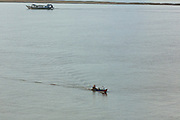 06 JUNE 2014 - IRRAWADDY DELTA,  AYEYARWADY REGION, MYANMAR: Boats on the Irrawaddy River in the Irrawaddy Delta (or Ayeyarwady Delta) in Myanmar. The region is Myanmar's largest rice producer, so its infrastructure of road transportation has been greatly developed during the 1990s and 2000s. Two thirds of the total arable land is under rice cultivation with a yield of about 2,000-2,500 kg per hectare. FIshing and aquaculture are also important economically. Because of the number of rivers and canals that crisscross the Delta, steamship service is widely available.   PHOTO BY JACK KURTZ
