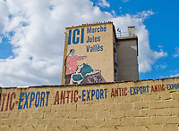 Sign on wall and building for the Paris flea market