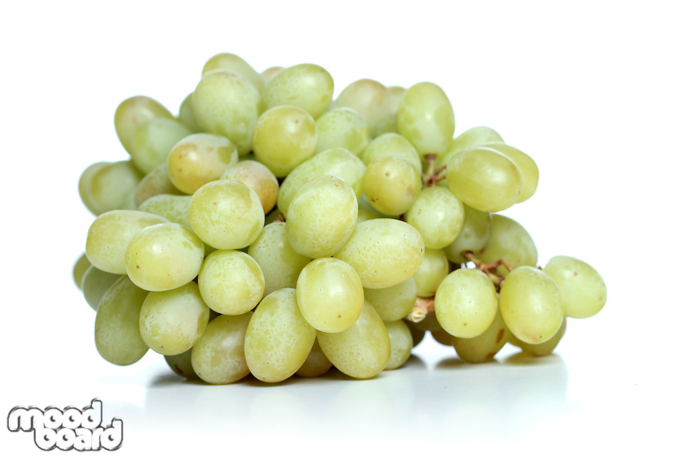 Bunch of green grapes on white background