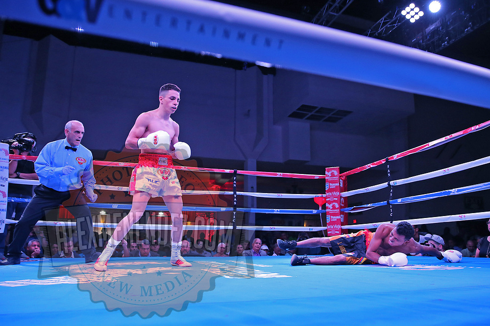 Agustin Gauto of Argentina Knocks out Jose Antonio Jiminez of Columbia as referee Frank Gentile looks on during their championship boxing match for the WBO Latin American light flyweight title at the Hotel El Panama Convention Center on Wednesday, October 31, 2018 in Panama City, Panama. (Alex Menendez via AP)