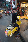 Motorbikes during rushhour. Girl with Vespa.