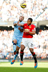 Pablo Zabaleta of Manchester City and Luis Antonio Valencia of Manchester United compete in the air - Photo mandatory by-line: Rogan Thomson/JMP - 07966 386802 - 02/11/2014 - SPORT - FOOTBALL - Manchester, England - Etihad Stadium - Manchester City v Manchester United - Barclays Premier League.