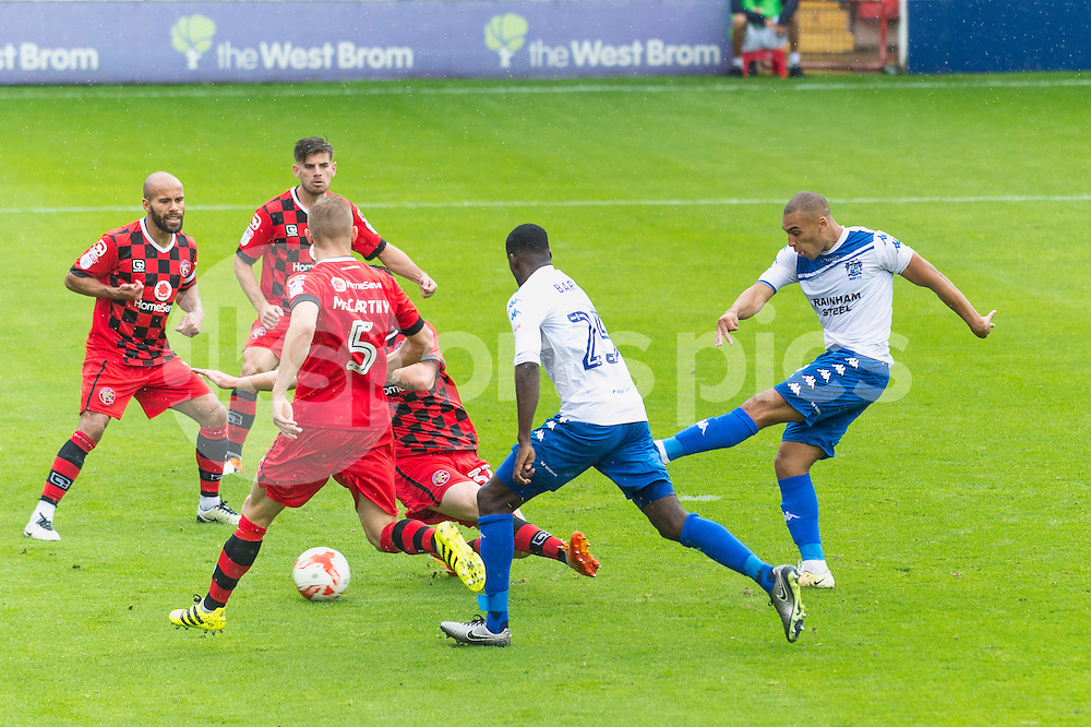 James Vaughan of Bury shoots and scores his sides second goal during the EFL Sky Bet League 1 match between Walsall and Bury at the Banks's Stadium, Walsall, England on 27 August 2016. Photo by Darren Musgrove.
