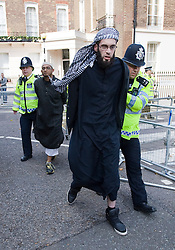 © licensed to London News Pictures. London, UK.  11/09/2011.  Two men are arrested by police for attempting to jump the barriers at service being held at the 9/11 memorial outside the U.S Embassy in London today (11/09/2011) to mark the 10th anniversary of the attack ono the Twin Towers in New York, in which over 2800 people died. Photo credit: Ben Cawthra/LNP