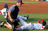 July 5, 2017 - Trenton, New Jersey, U.S - Trenton Thunder Strength Coach ANTHONY VELAZQUEZ helps Thunder player JORGEO MATEO stretch before the game tonight vs. the Fightin Phils at ARM & HAMMER Park. The team wore patriotic uniforms for the games on July 4th and today, July 5th. Behind Velazquez is Thunder outfielder TITO POLO. (Credit Image: © Staton Rabin via ZUMA Wire)