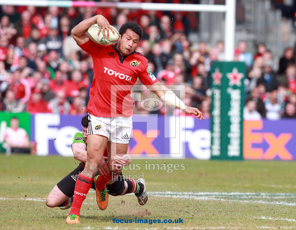 Picture by Paul Terry/Focus Images Ltd +44 7545 642257.07/04/2013.Tom Casson of Harlequins attempts to tackle Casey Lualala of Munster during the Heineken Cup match at Twickenham Stoop , London.