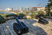 Israel, Jaffa 2 old cannons from the Ottoman period used to protect the Jaffa harbour Tel Aviv in the background