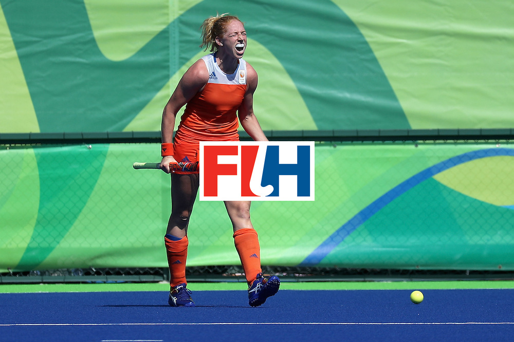 RIO DE JANEIRO, BRAZIL - AUGUST 17: Margot van Geffen #23 of Netherlands celebrates after scoring a goal during their sudden death shootout win over Germany during the women's semifinal match between the Netherlands and Germany on Day 12 of the Rio 2016 Olympic Games at the Olympic Hockey Centre on August 17, 2016 in Rio de Janeiro, Brazil.  (Photo by Rob Carr/Getty Images)