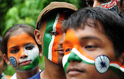 August 14, 2017 - Allahabad, Uttar Pradesh, India - Allahabad: Youth color their face with tricolor on the eve of Independence day celebration in Allahabad on 14-08-2017..Youth color their face with tricolor on the eve of Independence day celebration. (Credit Image: © Prabhat Kumar Verma/Pacific Press via ZUMA Wire)