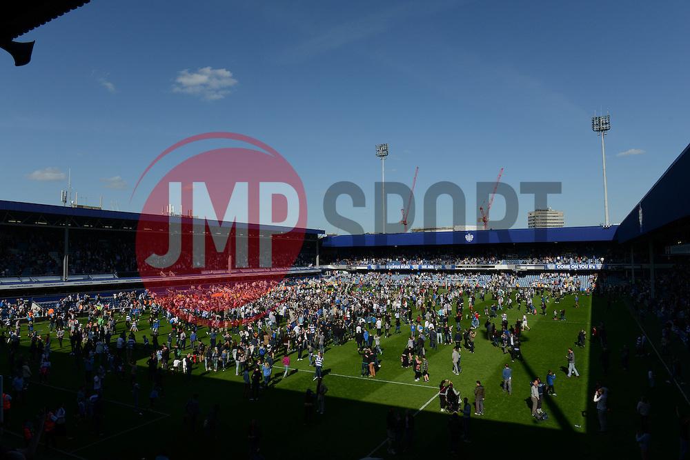 Pitch invasion at Loftus Road - Photo mandatory by-line: Dougie Allward/JMP - Mobile: 07966 386802 - 16/05/2015 - SPORT - football - London - Loftus Road - QPR v Newcastle United - Barclays Premier League