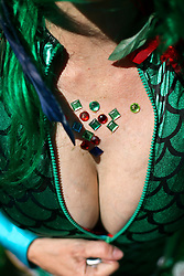 09 February 2016. New Orleans, Louisiana.<br /> Mardi Gras Day. the bright and the busty bursting out of costumes in the French Quarter. <br /> Photo©; Charlie Varley/varleypix.com