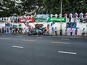 29 SEPTEMBER 2016 - BANGKOK, THAILAND:  Supporters of the residents of Pom Mahakan line the city wall in front of the old fort. Forty-four families still live in the Pom Mahakan Fort community. The status of the remaining families is not clear. Bangkok officials are still trying to move them out of the fort and community leaders are barricading themselves in the fort. The residents of the historic fort are joined almost every day by community activists from around Bangkok who support their efforts to stay.    PHOTO BY JACK KURTZ