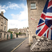 A Union Jack flies in the breeze at the entrance to a residential home in Painswick, Gloucestershire.