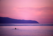 Barguzin Bay, dusk, fisherman, Zabaikalski  National Park, Lake Baikal. Lake Baikal is the oldest (25 million years), deepest (5700 feet) and largest lake in the world by volume(it holds 20% of the earth's liquid fresh water). Threatened by pollution and most recently by an oil pipeline, Baikal has become a rallying point for Russian and international conservationists. Baikal was declared a World Heritage Site in 1996. Boyd Norton, the photographer here, worked with Russian and U.S. environmentalists to get Baikal designated a World Heritage Site.