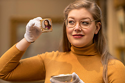 The Bonham's Home & Interiors Sale takes place on 21-22 February and features  a wide array of silver and porcelain.<br /> <br /> Pictured: Jaine Heggie  of Bonhams with a Naples Poulard Prad Portrait cup and saucer