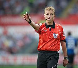 SWANSEA, WALES - Sunday, October 2, 2011: Referee Mike Jones takes charge of the Premiership match between Swansea City and Stoke City at the Liberty Stadium. (Pic by David Rawcliffe/Propaganda)