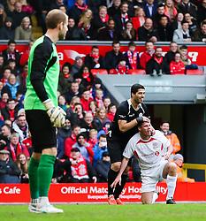 Luis Suarez jokes with Jamie Carragher - Photo mandatory by-line: Dougie Allward/JMP - Mobile: 07966 386802 - 29/03/2015 - SPORT - Football - Liverpool - Anfield Stadium - Gerrard's Squad v Carragher's Squad - Liverpool FC All stars Game